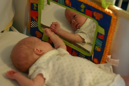 Miles and the baby in the mirror