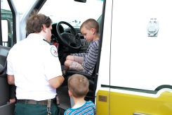 Oliver getting a bandaid from the EMT