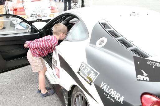 Miles peeking in a racecar