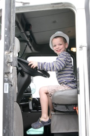 Oliver driving a cement mixer