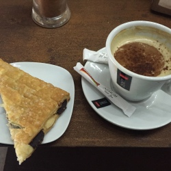 Birthday pastry and cappucino