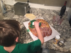 Linus helping with the king cake.