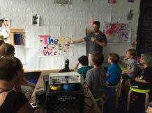 Their teacher introducing the film