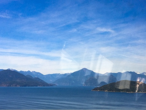 Mountains on the way! (And a bus window reflection)