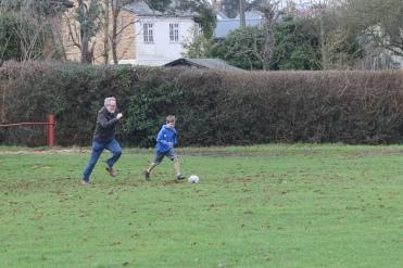 Mick and Dan playing football. Not soccer.