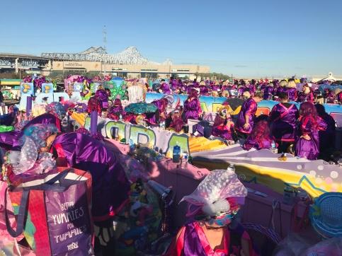 A sea of women on floats.