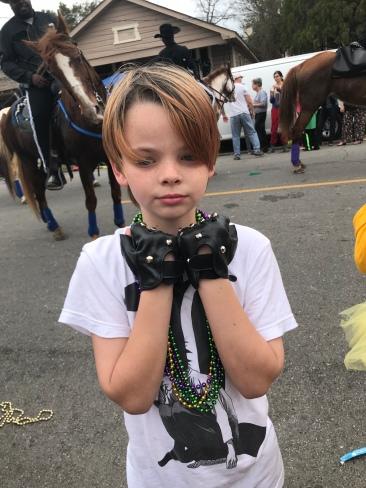 Oliver's studded pleather fingerless gloves he caught
