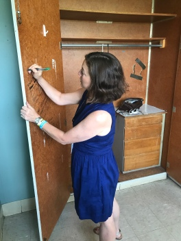 Kelly leaving her mark (with everyone else's!) on her old closet door
