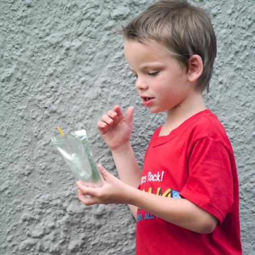 Miles contemplates his juice.