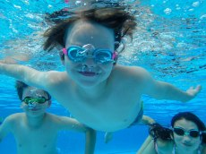 Linus and Miles and Ellie underwater