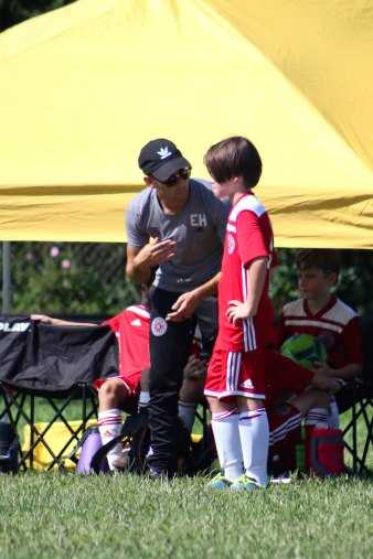 Miles getting a pep talk from the coach